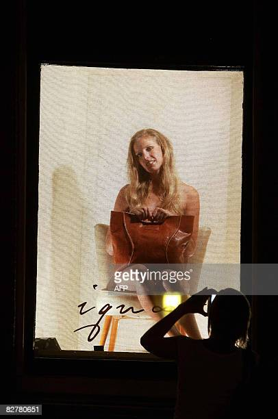 A model presents an outfit of Dutch designers such as Daryl van der Wouw Jan Taminiau and Bas Koster in the windows of the Red Light District in...