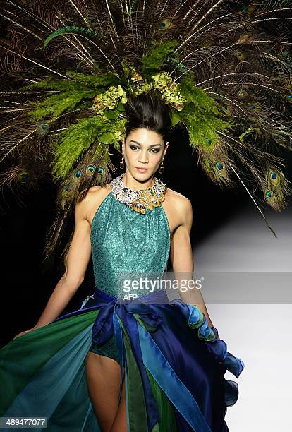 A model presents Autumn/Winter 20142015 collection creations by Francis Montesinos during Madrid Fashion Week in Madrid on February 15 2014 AFP PHOTO...