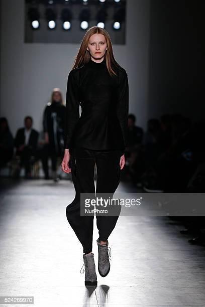 Model presents Autumn/Winter 2015 creation by designer Aleksandar Protic during the 44rd edition of Moda Lisboa Fashion Week at the Patio da Gale on...