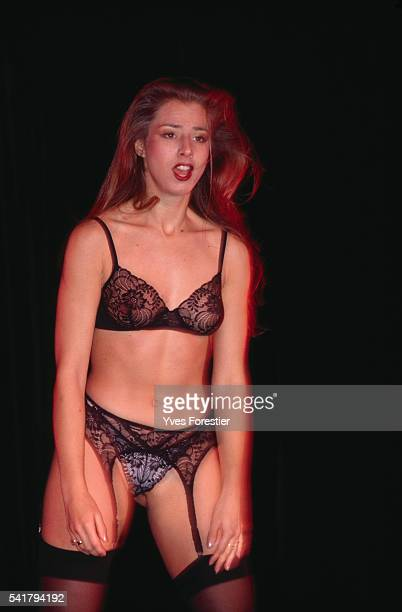 A model presents black lingerie at the 6th Eroticism Convention in Paris