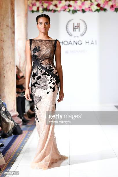 A model presents Celebrity Designer to Miss France and Miss Universe Hoang Hai of Vietnam at season 3 of Tiffany's Red Carpet Week Cannes Fashion...