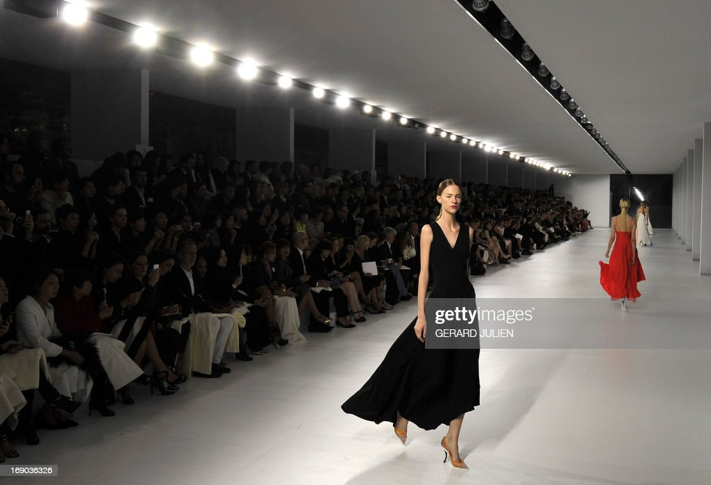 Model presents creation by Belgian designer Raf Simons for Christian Dior during the collection show entitled 'Croisiere 2014' (Cruise) , on May 18, 2013 in Monaco.