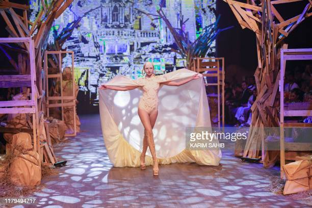 A model presents creations by Amato during the Fashion Forward event at the Dubai Design District in Dubai on November 2 2019