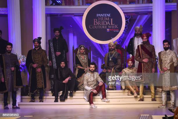 Model presents creations by designer Ahsan on the last day of the Pantene Hum Bridal Couture Week in Lahore on December 10 2017 / AFP PHOTO / ARIF ALI