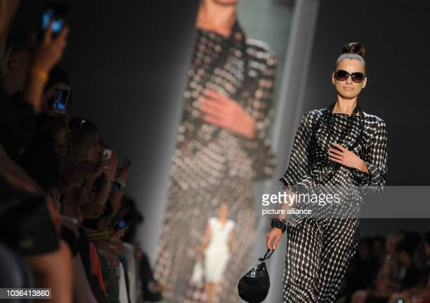 A model presents creations by fashion designer Guido Maria Kretschmer for  spring summer 2015 during de1821abd0