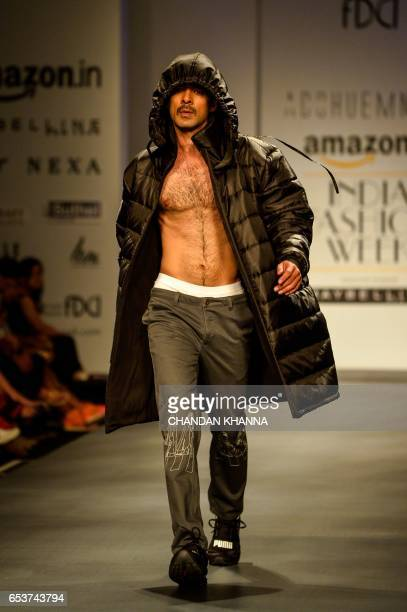 A model presents creations by Indian designers Pranav Mishra and Shyma Shetty during the Amazon India Fashion Week Autumn Winter 2017 in New Delhi on...