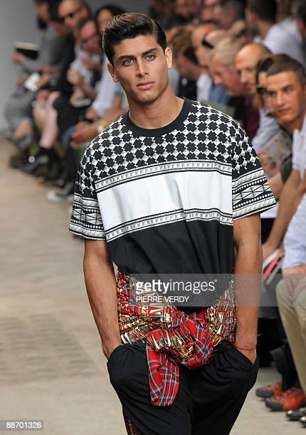 Model presents creations by Italian designer Riccardo Tisci for the Givenchy fashion house as part of the men's 2009-2010 spring-summer ready to wear...