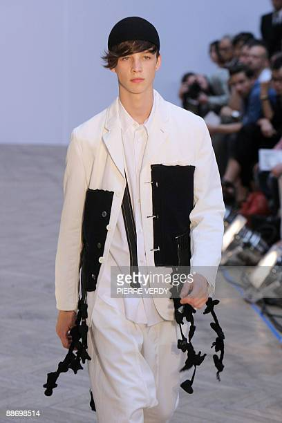 A model presents creations by Japanese designer Rei Kawakubo for the Comme des Garcons fashion house as part of the men's 20092010 springsummer ready...