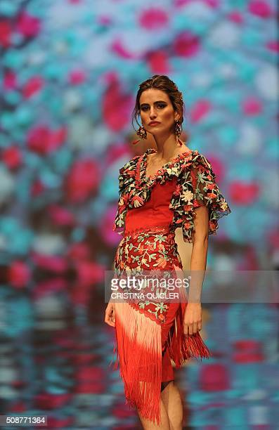 A model presents creations by Loli Vera during the SIMOF 2016 in Sevilla on February 6 2016 AFP PHOTO/ CRISTINA QUICLER / AFP / CRISTINA QUICLER