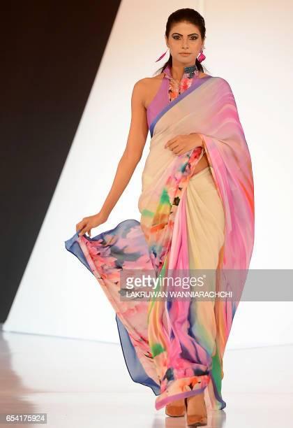 Model presents creations by Sri Lankan fashion designer Jaishree Jayasingha at the Colombo fashion week on March 16, 2017. / AFP PHOTO / LAKRUWAN...