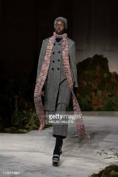 A model presents creations from British designer Alexa Chung during during their 2019 Autumn / Winter collection catwalk show at London Fashion Week...