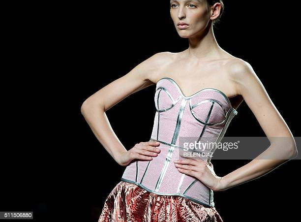 A model presents creations from Maya Hansen's Autumn/Winter 20162017 collection during the MercedesBenz Madrid Fashion Week in Madrid on February 21...