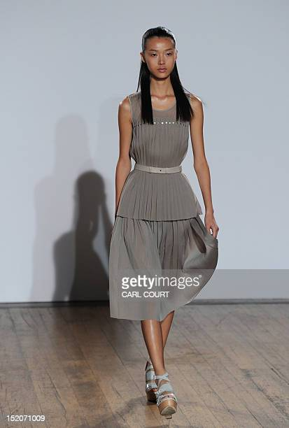 A model presents creations from the 2013 spring/summer collection of designer Nicole Farhi at London Fashion Week in London on September 16 2012 AFP...