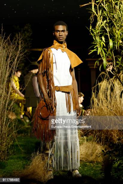 A model presents creations of Palomo Spain during the last day of the MercedesBenz Fashion Week Madrid on January 28 2018 in Madrid Spain
