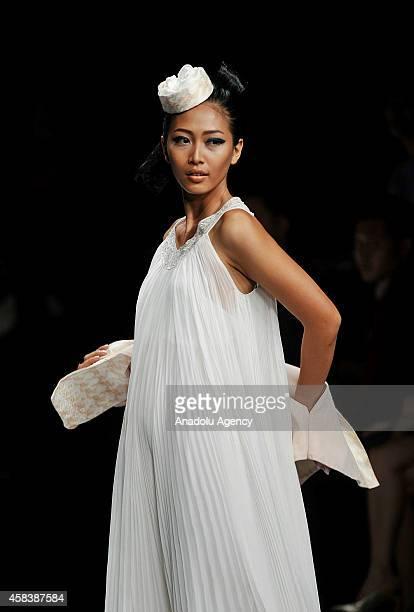 A model presents creations on the runway by Jennyfer Owen during Jakarta Fashion Week 2015 in Jakarta November 4 2014