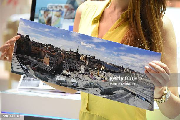 A model presents Epson photo prints at the Photokina 2014 trade fair on September 15 2014 in Cologne Germany Photokina is the world's largest trade...