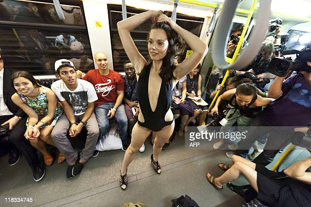 """Model presents fashion at the """"Underground Catwalk"""" show during the Berlin Fashion Week on July 6, 2011. The fashion show took place in a driving..."""