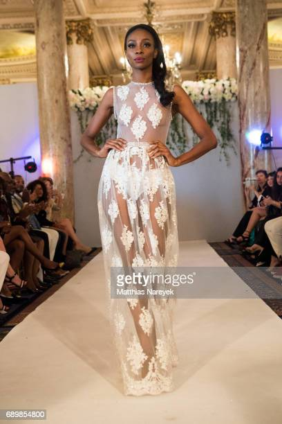 A model presents fashion designed by Najla Rahimi Collections Toronto Canada during Tiffany's Red Carpet Week Fashion Show at Carlton Hotel on May 23...