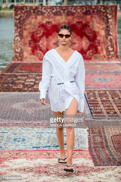 Model presents fashion during the MUF10 show at Copenhagen Fashion Week SS20 at Soepavillionen on August 6, 2019. / Denmark OUT