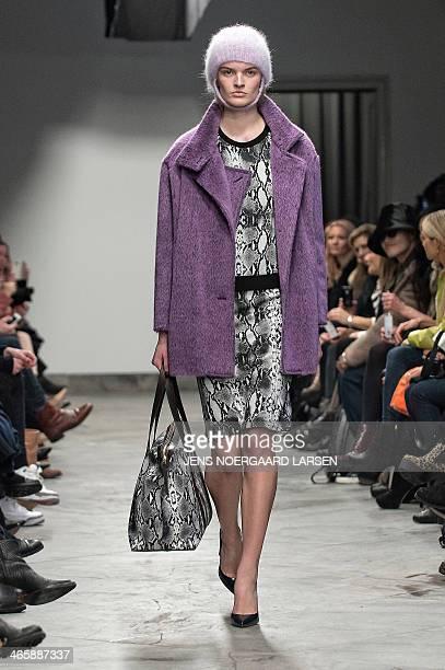 Model presents fashion from the Autumn/Winter 2014 collection by the label Baum und Pferdgarten fashion house during the Copenhagen Fashion Week in...