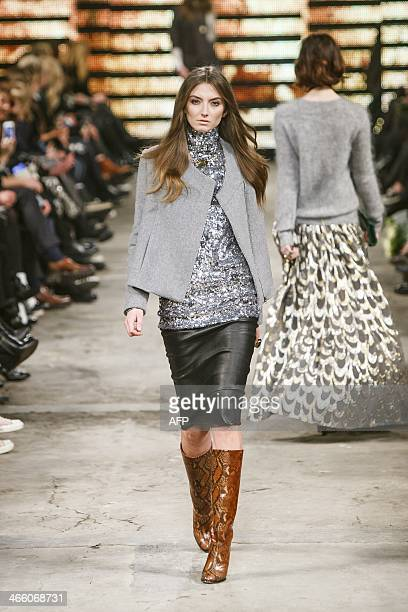 A model presents fashion from the Autumn/Winter 2014 collection of the Danish label Malene Birger during the Copenhagen Fashion Week in Copenhagen...
