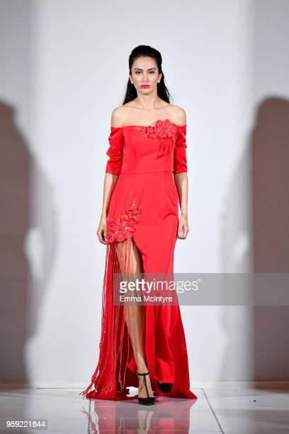 A model presents Kiki Wang of Hollywood USA at season 3 of Tiffany's Red Carpet Week Cannes Fashion Show at Carlton Hotel on May 15 2018 in Cannes...