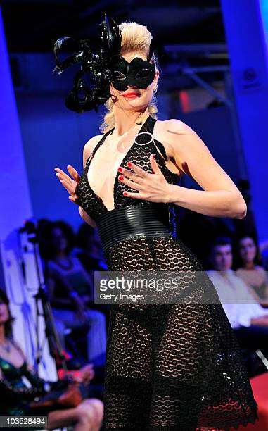 AUGUST 21 A model presents latest chicque in rubber fashion of label bodycult during a fashion show at the Latexpo 2010 at the Edelfettwerk on August...