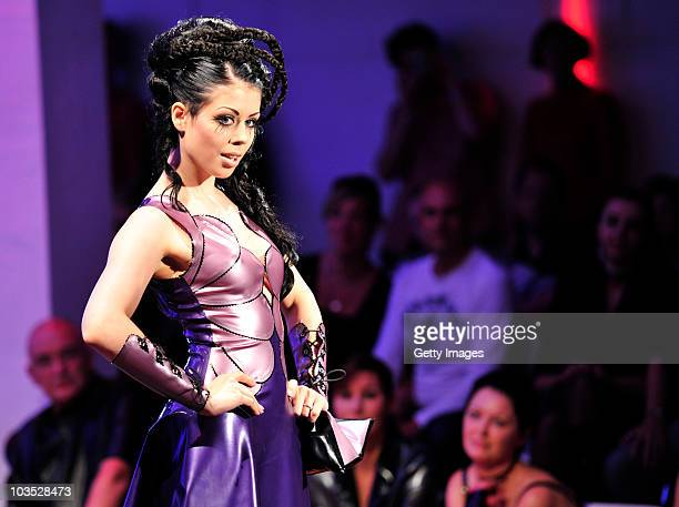 AUGUST 21 A model presents latest chicque in rubber fashion of label Rosengarn during a fashion show at the Latexpo 2010 at the Edelfettwerk on...