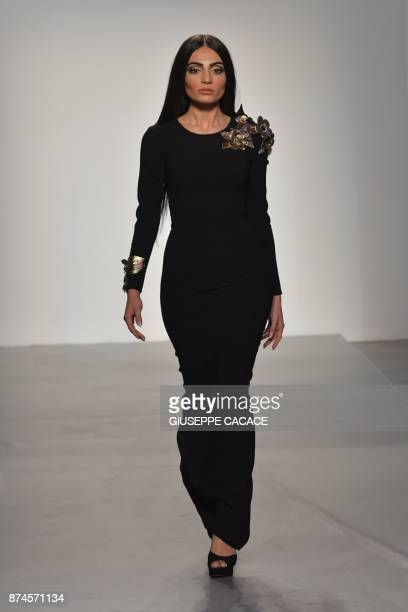 A model presents on the catwalk a creation of Aiisha Ramadan during the Arab Fashion Week in the United Arab Emirate of Dubai on November 15 2017 /...