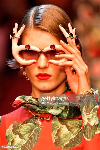 A model presents sunglasses for fashion house Dolce Gabbana during the Women's Spring/Summer 2018 fashion shows in Milan on September 24 2017 / AFP...