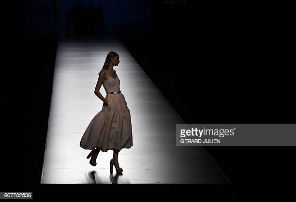 TOPSHOT A model presents The 2nd Skin Co's Spring/Summer 2017 collection during the Madrid Fashion Week in Madrid on September 19 2016 / AFP / GERARD...