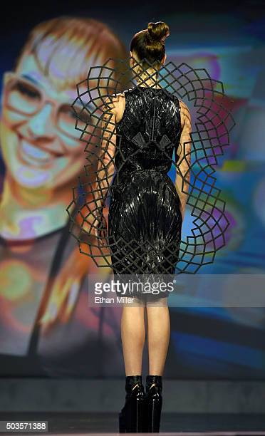 A model presents the Chromat Adrenaline Dress made of 3Dprinted panels and featuring Intel's Curie Module during a keynote address by Intel Corp CEO...