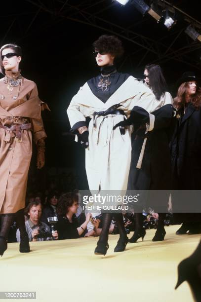 A model presents the collection by French designer JeanPaul Gaultier 19 March 1983 in Paris French designer JeanPaul Gaultier talks with Ines de La...