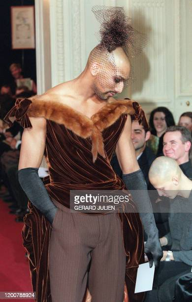 A model presents the collection by French designer JeanPaul Gaultier 27 January 1996 in Paris during the 9697 Autumn/Winter men's readytowear show...
