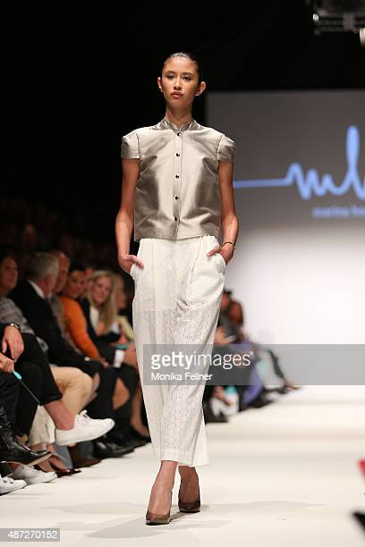 A model presents the collection of Marina Hoermanseder at the opening show during the MQ Vienna Fashion Week on September 7 2015 in Vienna Austria