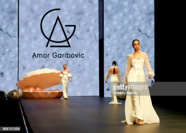 A model presents the creation of Amor Garibovic who is last year's winner of Bridal Gown Design Contest at the 12th IF Wedding Dresses Suits and...