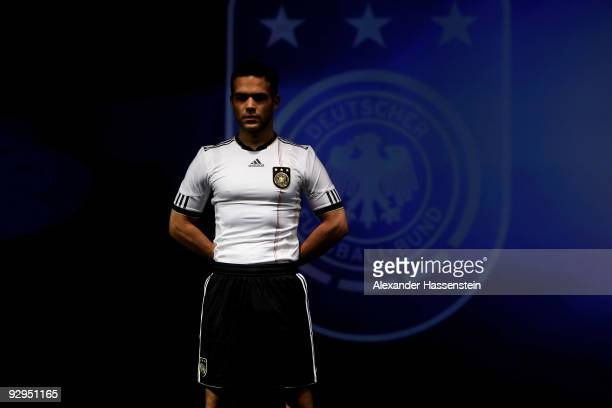 A model presents the new German FIFA World Cup 2010 jersey 'Teamgeist' at the adidas Brand Center on November 10 2009 in Herzogenaurach Germany