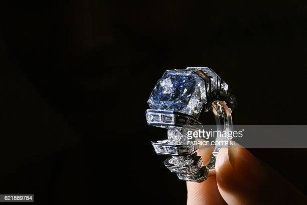 A model presents the The Sky Blue Diamond a fancy vivid blue diamond ring created by Cartier during a press preview by Sotheby's Auction House on...