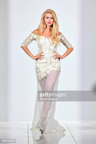A model presents Tiffany McCall Couture of Paris France at season 3 of Tiffany's Red Carpet Week Cannes Fashion Show at Carlton Hotel on May 15 2018...