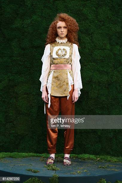 A model prsesents designs at the presentation for designer Ozlem Suer show during MercedesBenz Fashion Week Istanbul on October 13 2016 in Istanbul...