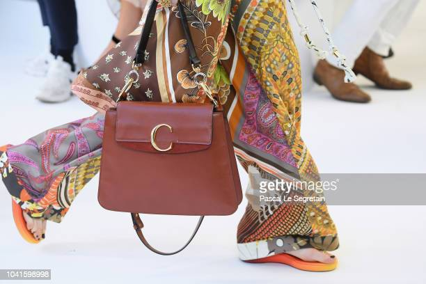 A model purse detail walks the runway during the Chloe show as part of the Paris Fashion Week Womenswear Spring/Summer 2019 on September 27 2018 in...