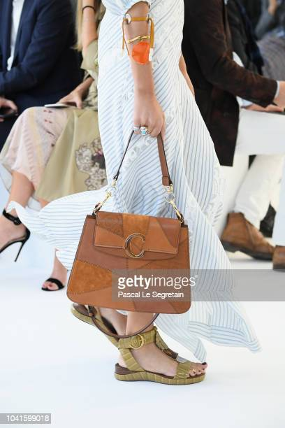 Model, purse detail, walks the runway during the Chloe show as part of the Paris Fashion Week Womenswear Spring/Summer 2019 on September 27, 2018 in...