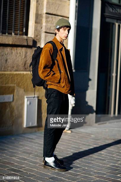 fecf15bae3 Model Raad Al Gabril wears a green beanie brown suede bomber jacket green  shirt black jeans