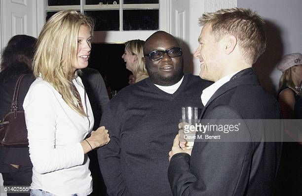 Model Rachel Hunter actor Ade and singer Bryan Adams attend a exhitibition of photographs by rocker Bryan Adams benefitting ASDA's Tickled Pink...