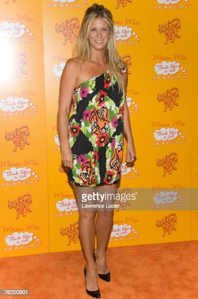 Model Rachel Hunter arrives at the Meow Mix Acatemy Orange Carpet Party August 20 at the Daryl Roth Theater in New York City