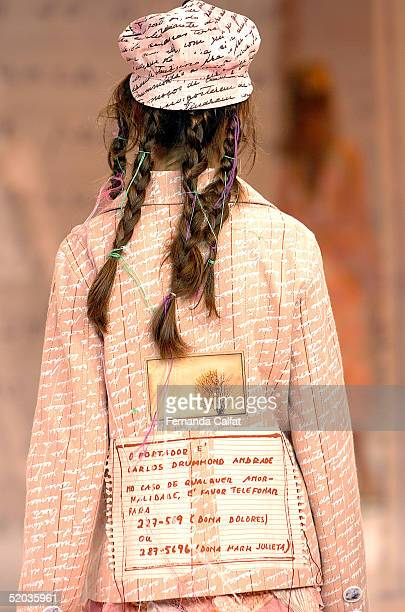 Model Raquel Lieven presents a creation by designer Ronaldo Fraga during the Fall/Winter 2005 collection of the Sao Paulo Fashion Week at Parque...