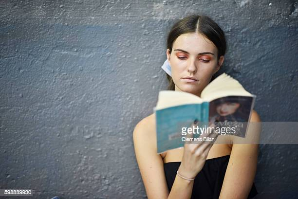 Model reads a book backstage ahead of the Selected Femme/Homme fashion show during the Bread & Butter by Zalando at arena Berlin on September 3, 2016...
