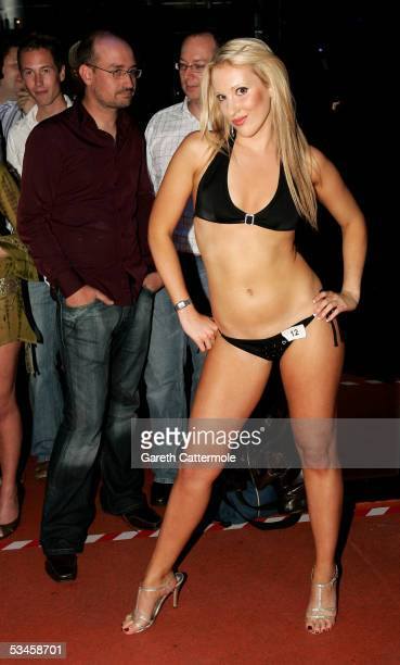 Model Rebecca Clare poses as she participates in the catwalk show for the Gridmodels 2006 Calendar Catwalk Competition at The Penthouse on August 24...