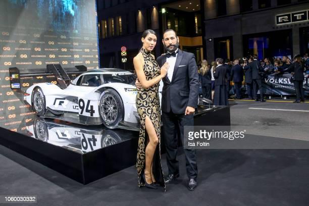 Model Rebecca Mir and her husband dancer Massimo Senato arrive for the 20th GQ Men of the Year Award at Komische Oper on November 8 2018 in Berlin...