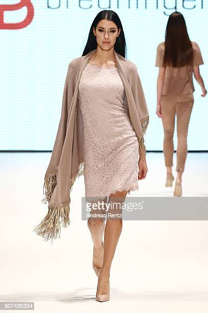 Model Rebecca Mir walks the runway at the Breuninger show during Platform Fashion January 2016 at Areal Boehler on January 29 2016 in Duesseldorf...
